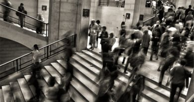 People walking into a station